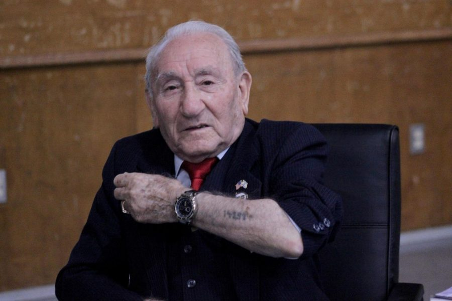 Holocaust survivor Joseph Alexander displays his identification tattoo on his forearm during a presentation he gave at Monroe High School on Nov. 14.
