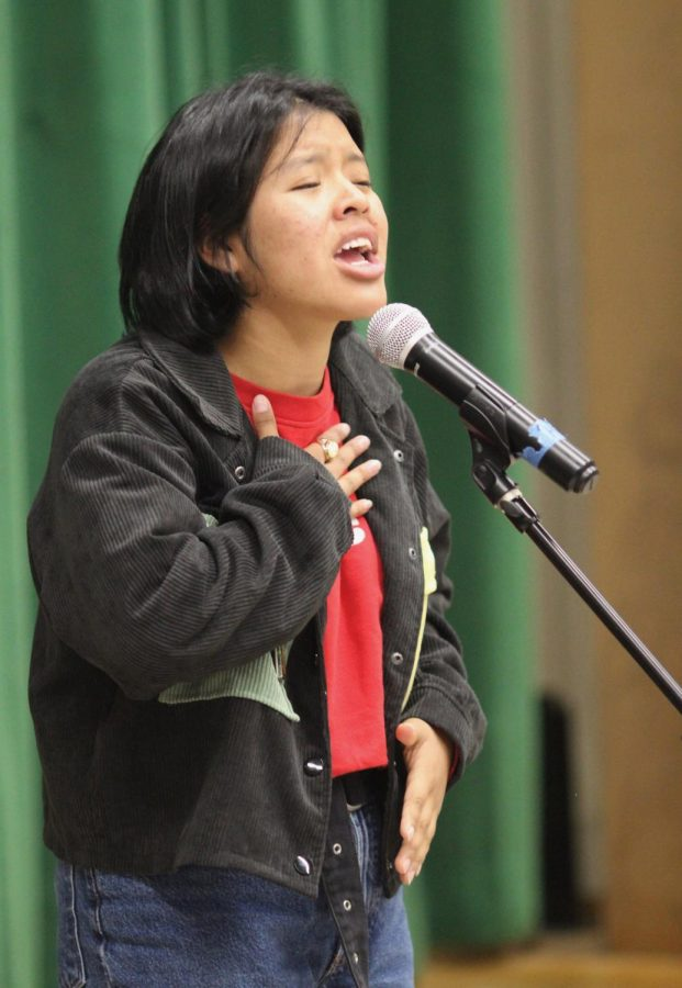 """Get Lit poet Vanessa Tanay pours her emotions into performing her classic poem, """"Elena"""" during the Get Lit assembly on Nov. 21."""