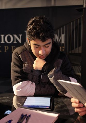 Senior Ivan Moreno analyzes his information for The Situation Room Experience at the Ronald Reagan Library field trip on Dec. 2.