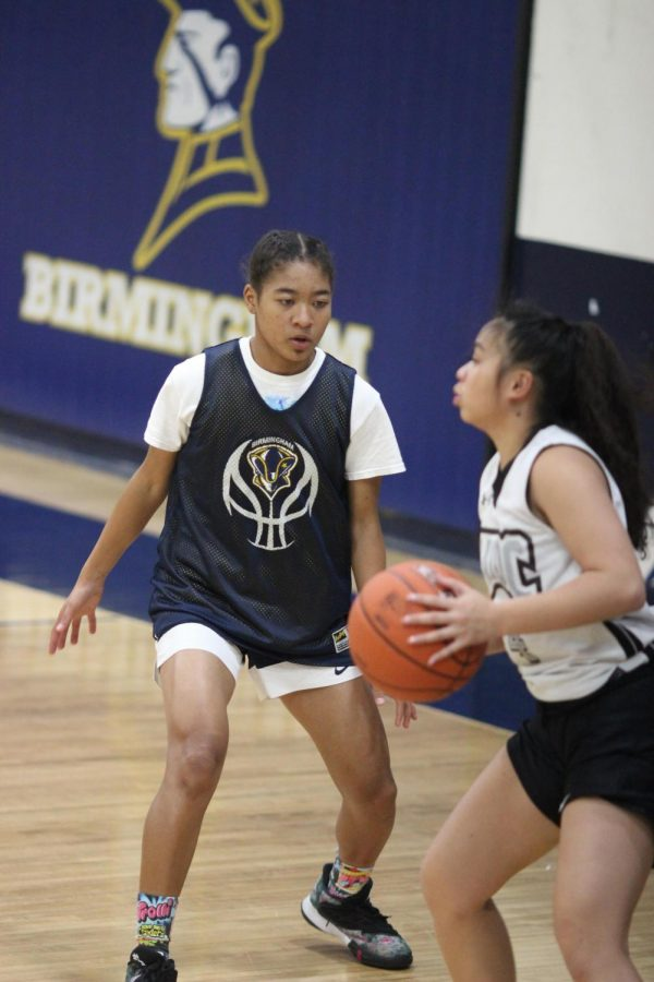 Sophomore varsity player Janna Holley plays defense against a teammate during practice game on Nov. 18.