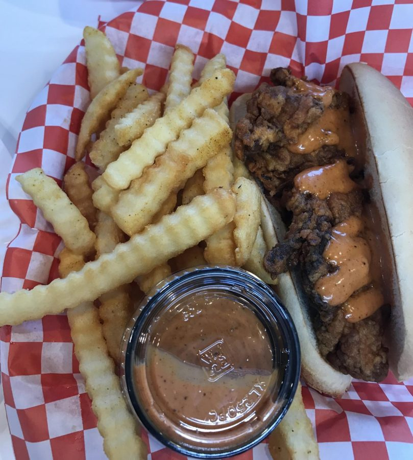 The Kluckin Chicken sells their classic chicken sandwich with their Klucking sauce and crinkle-cut fries.