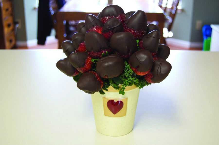 Chocolate+covered+strawberries+bouquet%3A+%0ASimple+easy+and+tasty+diy+gift.+All+you+need+are+strawberries%2C+two+packets+of+chocolate+melts%2C+sprinkles%2C+bamboo+skewers+and+tissue+paper.+First+you+wash+the+strawberries%2C+then+melt+the+chocolate+and+dip+the+strawberries+into+the+%0Achocolate.+As+it+starts+to+cool+down%2C+add+the+%0Asprinkles.+Once+everything+is+dry%2C+wrap+them+nicely+in+tissue+paper+and+add+a+little+note.