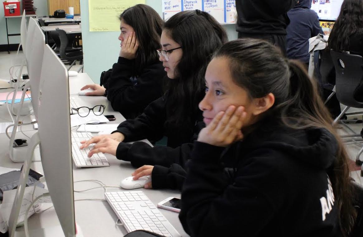Staff writers Valery Barrera, Valeria Luquin and Maribella Ambrosio work during period 3 on Jan. 29. Student media staff, who produce content for the yearbook, news magazine, website and social media, all work together in one class period.