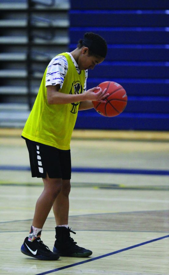 Sophomore varsity point guard Janna Holley prepares to shoot a free throw during practice on Jan. 30.
