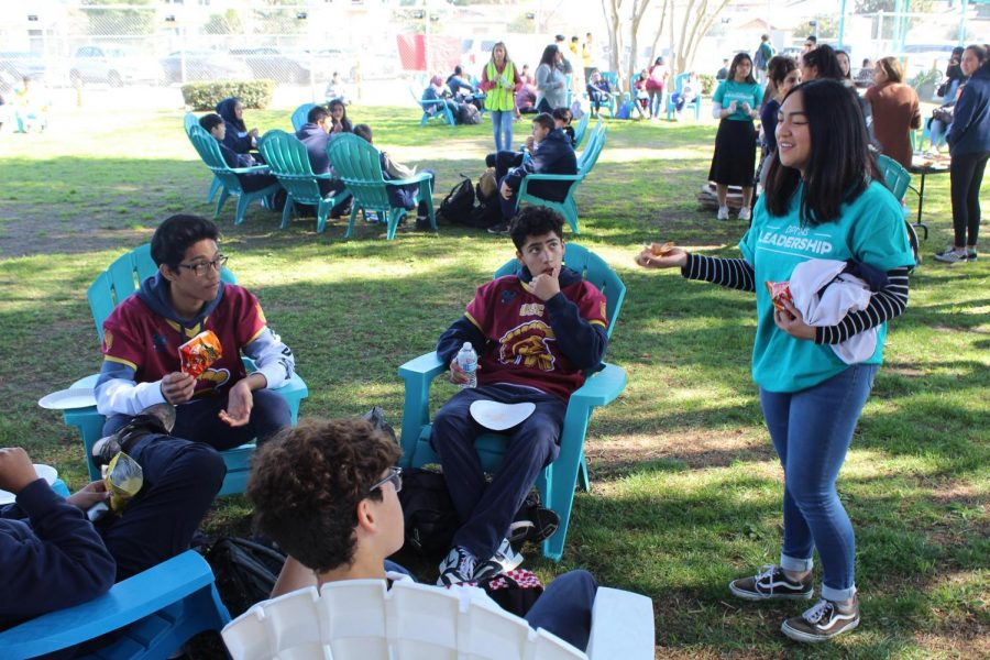 ASB+President+Bianca+Lam+talks+to+mIddle+School+students+during+Fiesta+Friday+on+Feb.+7.+Students+were+provided+with+lunch+and+snacks.