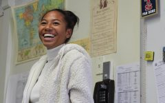 Black Student Union President Cassia Ramelb laughs at a joke made by a BSU club member during a meeting.