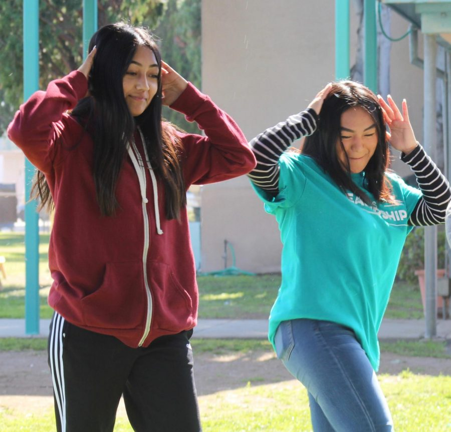 ASB President Bianca Lam dances with a middle school student for a Tik Tok during Fiesta Friday on Feb. 7.
