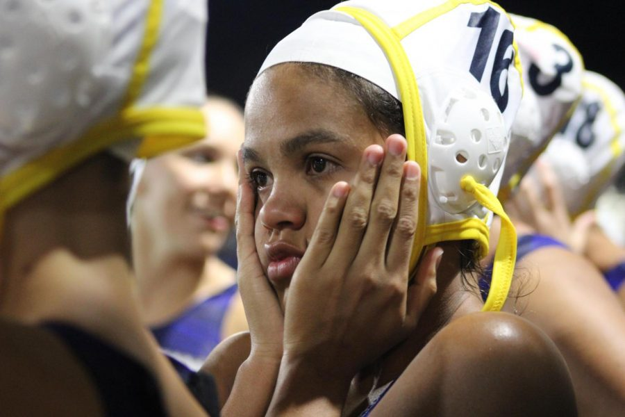 Varsity girls water polo player Julissa Jaco stands in shock and teary eyed after an immensely tense game. The City Championship game was held at Los Angeles Valley College on Feb. 20 where the Lady Patriots went up against Palisades Charter High School winning 17- 16.