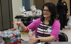 Resource teacher Jennifer Walker grabs a snack as she recovers from getting her blood drawn at a past Red Cross Blood Drive. (file photo)