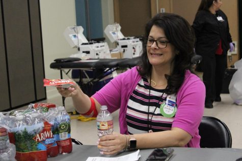 Resource teacher Jennifer Walker grabs a snack as she recovers from her blood transfusion at the Red Cross Blood Drive on Feb. 27. The drive made sure to take care of their patients and help them recover in the following 15 minutes after their transfusion.