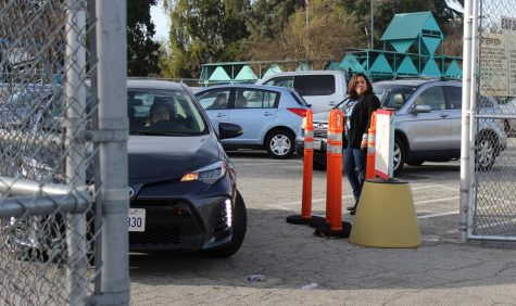 School counselor Martina Torres makes no cars turn left at the exit toward Balboa Boulevard.