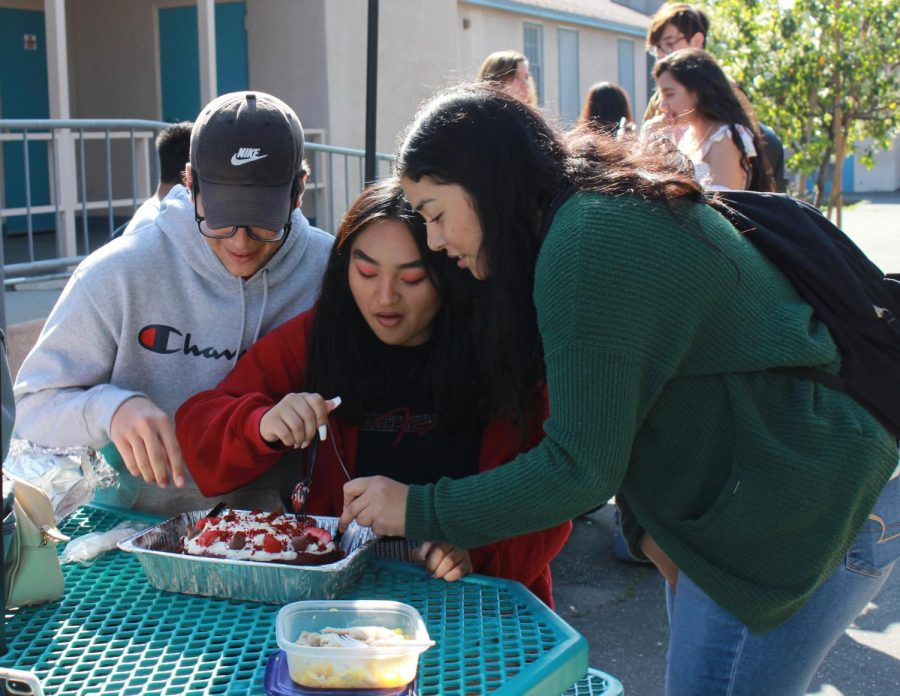 Seniors Larry Chavez, Bianca Lam and Brenda De Dios share a sweet treat on Feb. 14 for Valentine's Day during lunch.