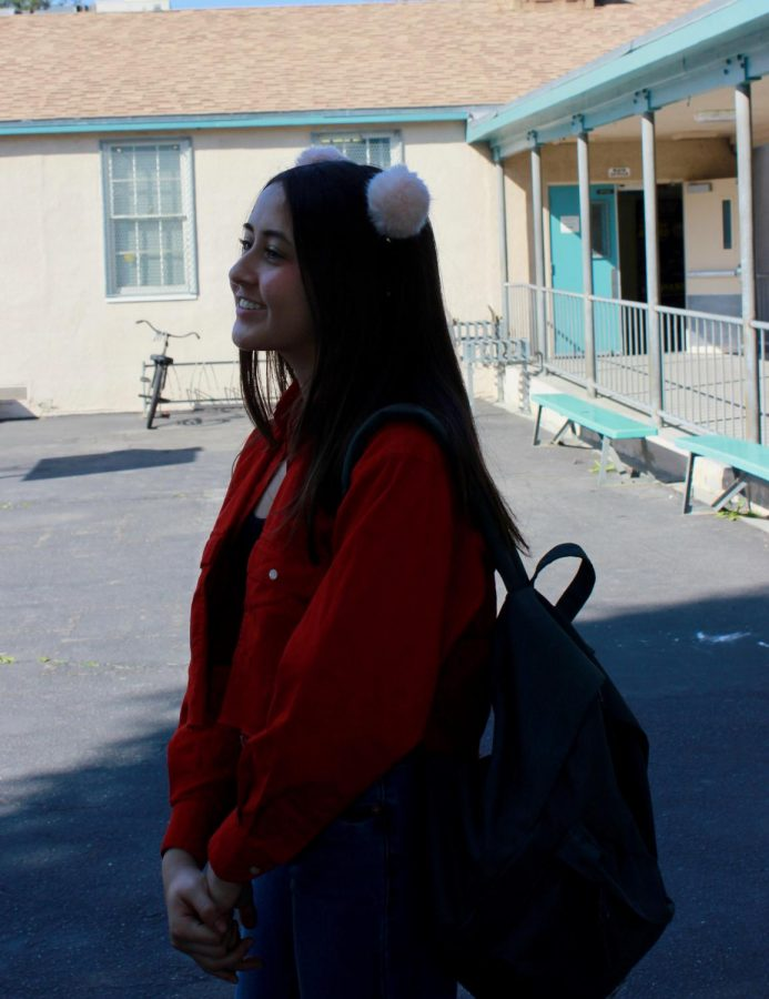Showing all the love, senior Karen Ticas participates in Valentine's spirit day by wearing red and pink on Feb. 14 during lunch.
