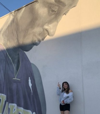 Sophomore Eden Kolber at a mural honoring the late basketball player Kobe Bryant.