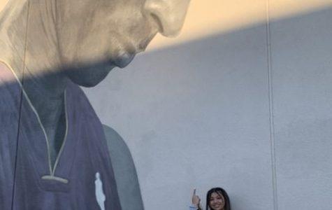 Sophomore Eden Kolber at a mural honoring the late basketball player Kobe Bryant.