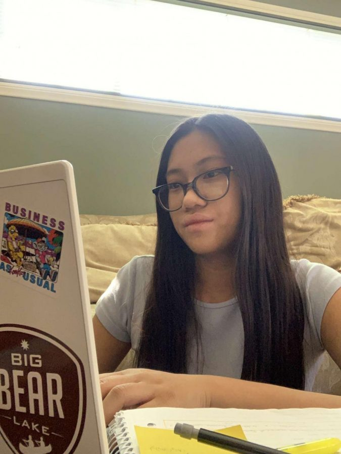 Sophomore Chareena Pascua works on her online schoolwork during this remote learning semester.