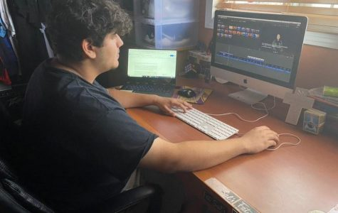 New Media Editor Christopher Sarenana edits a video for the website. The rest of the publication staff continues to produce content as well.