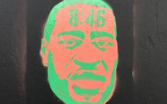 Graffiti art of George Floyd on Hollywood Boulevard with 8:46 on the top showing how long Officer Chauvin was on Floyds neck