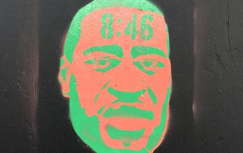 Graffiti art of George Floyd on Hollywood Boulevard with 8:46 on the top showing how long Officer Chauvin was on Floyd's neck