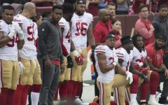 Players from the San Francisco 49ers kneel for the National Anthem in support of their teammate Colin Kaepernick. Kaepernick's protests sparked many other NFL players across the league to follow his movement.