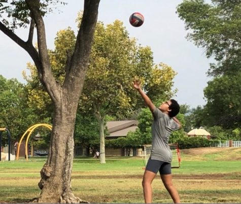 Sophomore and varsity volleyball player Naamah Silcott gets ready to return to practice by strengthening her volleyball skills.