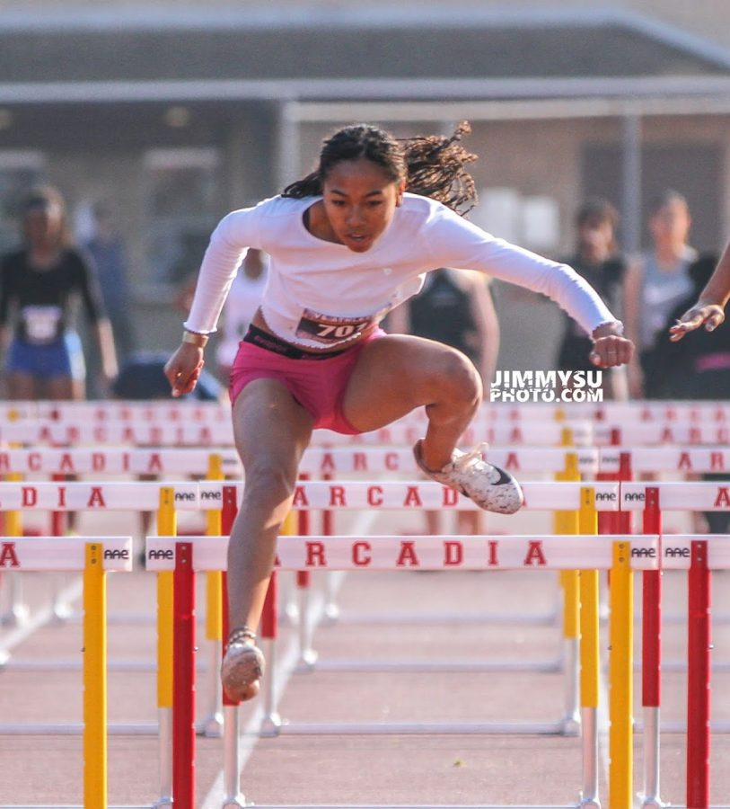 Senior Cassia Ramelb jumps over a hurdle during a track meet. Ramelb has been running track for BCCHS during all four years of high school.