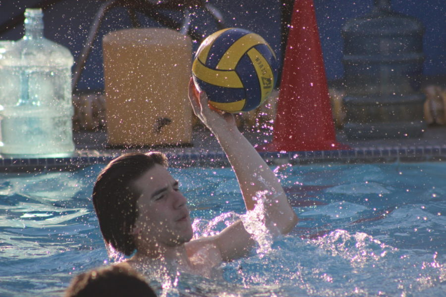 Senior August Defore gets ready to pass the ball during water polo practice on March 17.