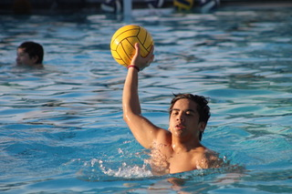 Senior CJ Gorospe gets ready to score during water polo practice on March 17.