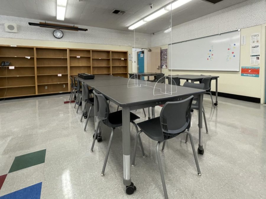 The library at Daniel Pearl Magnet High School has been set up to ensure that students are able to social distance.
