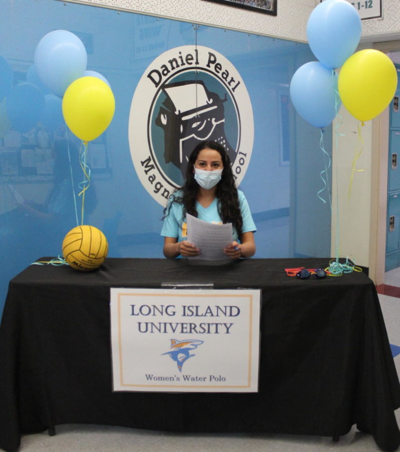 Senior Amelia Sanchez smiles as she officially commits to Long Island University to play water polo. Sanchez is the first DPMHS athlete in five years to play on a Division 1 sports team.