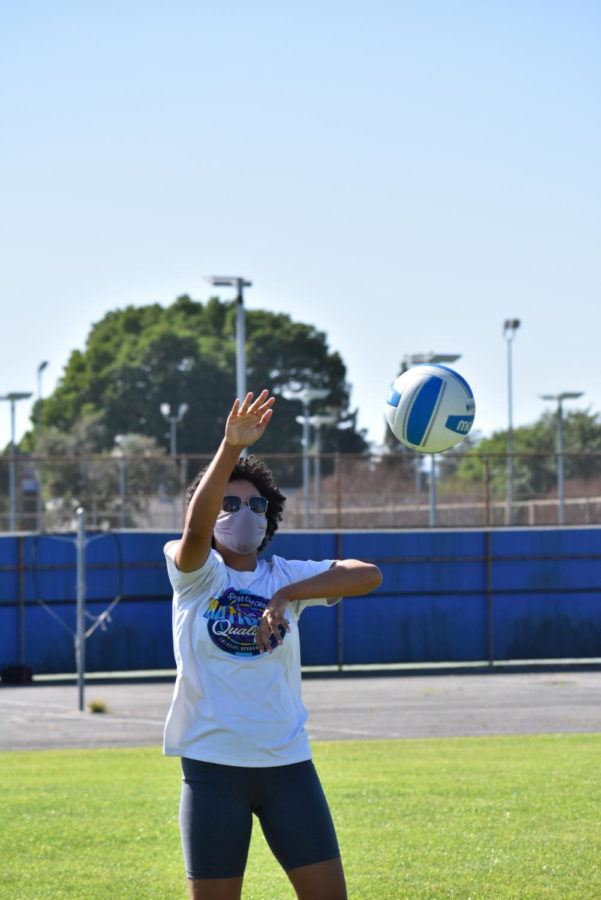 Sophomore Naamah Silcott hits the ball during volleyball practice on April 9.