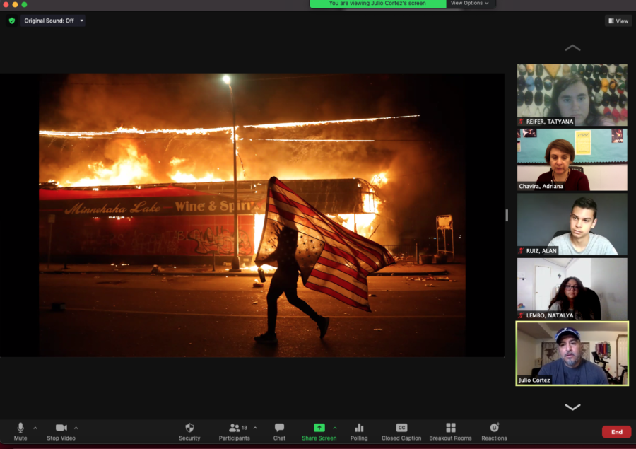 Photographer Julio Cortez shares some of his best pictures with the Period 2 Photography class. This photo was captured during the riots in Minneapolis following the death of George Floyd in May 2020.