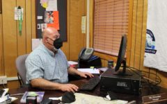 Principal Armen Petrossian works in his office at Daniel Pearl Magnet High School. Petrossian's first official day as principal of DPMHS was on Oct. 5, after the previous principal stepped down.