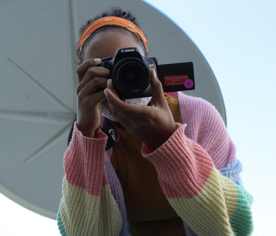 Junior Naamah Silcott takes practice photos from a birds eye view during their first period Experimental Photography class on Sept. 27.