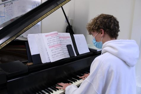 """Senior Spencer Vance practices during lunch on Oct. 6 for his piano solo of Rachmaninoff's """"Prelude."""""""