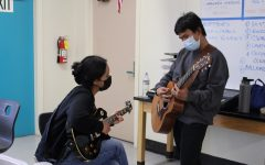 Seniors Daniela Rangel and Jose Arcilla practice different guitar riffs during lunch in music teacher Wes Hambrights classroom on Oct. 6.