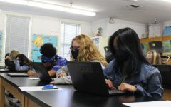 Juniors Jenica Felicitas, Angela Ledesma-Grattarola and Naamah Silcott take an online exam during their second period AP Environmental Science class at DPMHS after coming back to school from distance learning.